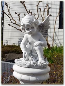 The angel sculpture in the front yard